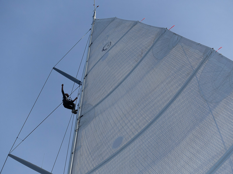 Giamma looking over the mast and mainsail