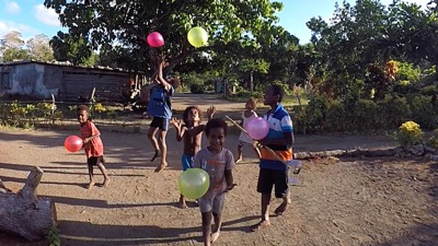 Village kids with balloons